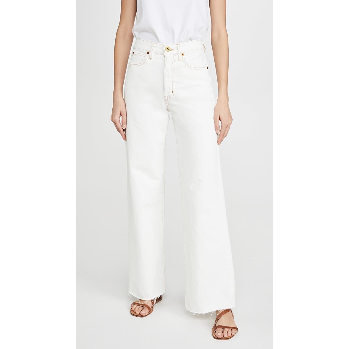 Grace frayed high-rise flared jeans in Natural White