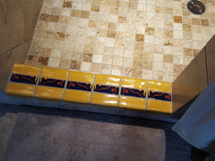 Mexican tile bathroom shower threshold