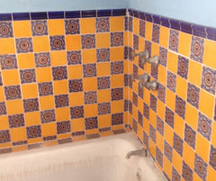 Mexican tile bathroom tub surroundings with trim