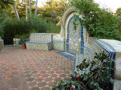 Mexican tile outdoor fountain and arch