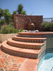 Mexican tile outdoor pool with stairs
