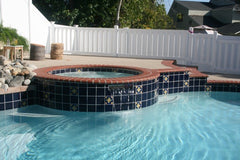 Mexican tile outdoor pool with hot tub