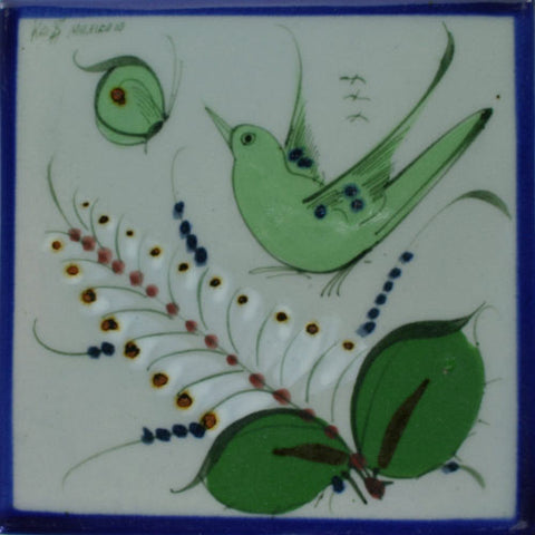 Ken Edwards green bird and butterfly tile