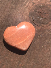 Load image into Gallery viewer, Peach Moonstone Carved Heart Tumbled