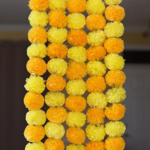 orange yellow marigold decoration garlands from aangan of india;  These party decoration garlands are perfect for Diwali, halloween, day of the dead and Fall wedding.  Perfect for Indian and American theme weddings and events