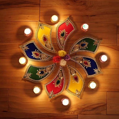 Aangan of India handcrafted rangoli tabletop decor with hand painted diya wax candles decorated with flowers. Perfect for Christmas and henna / mehndi night
