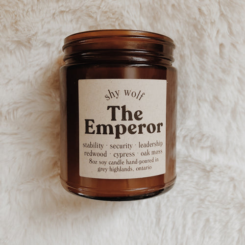 Shy Wolf The Emperor candle with redwood cypress, and oak moss.