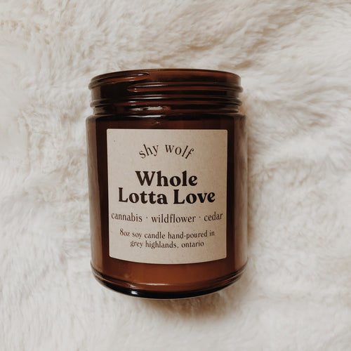 Shy Wolf Whole Lotta Love candle with scents of cannabis, wildflower, and cedar.
