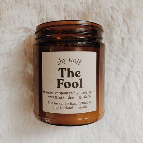 Shy Wolf The Fool candle with sweetgrass, dew, and gardenia.