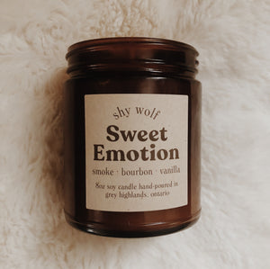 Shy Wolf Sweet Emotion candle with smoke, bourbon, and vanilla.
