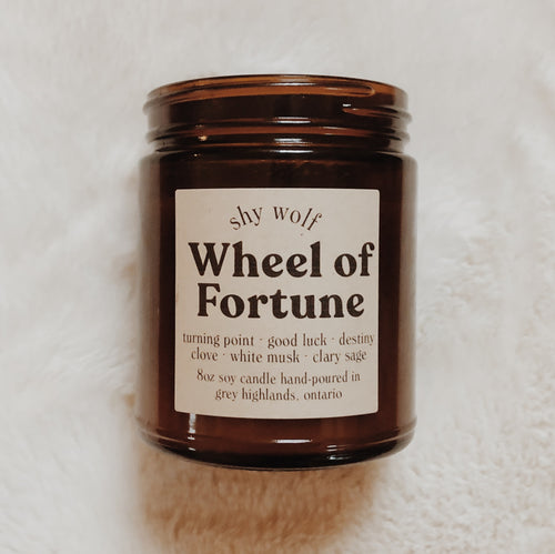 Shy Wolf Wheel of Fortune candle with scents of clove, white musk, and clary sage.