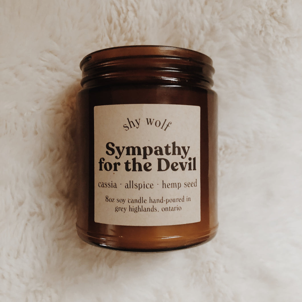 Shy Wolf Sympathy for the Devil candle with cassia, allspice, and hemp seed.