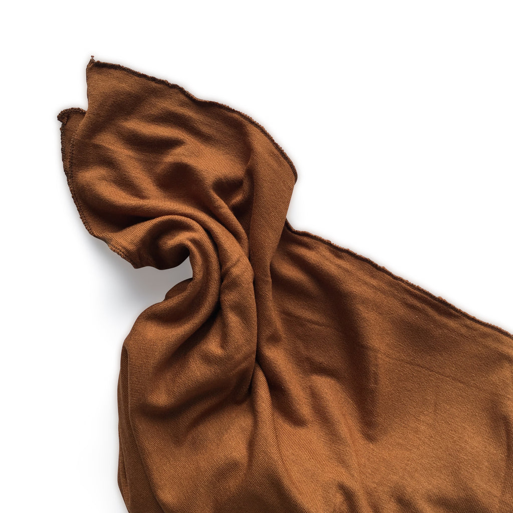 I AM BCO Conscious Lifestyle Stretch Swaddle Cotton fabric Rust