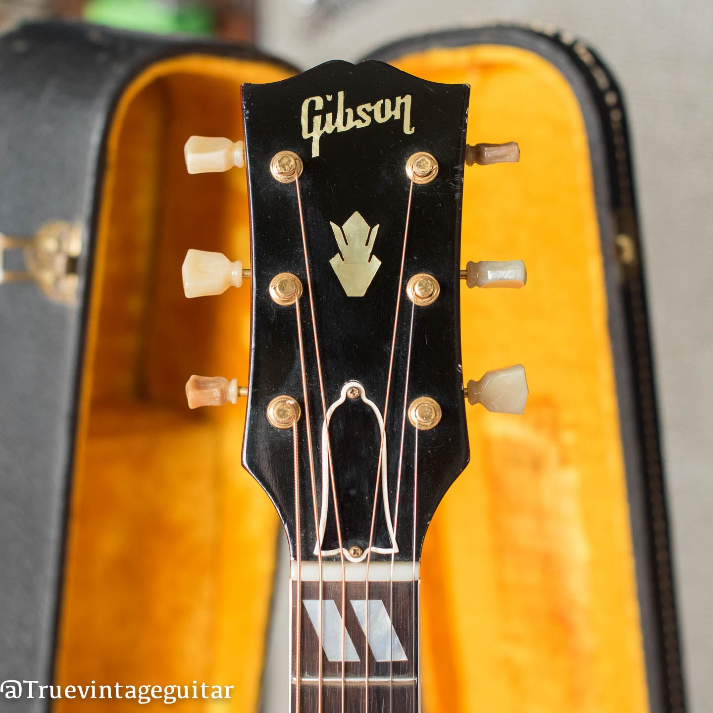 Headstock, pearl Gibson logo, Vintage 1963 Gibson Hummingbird acoustic guitar