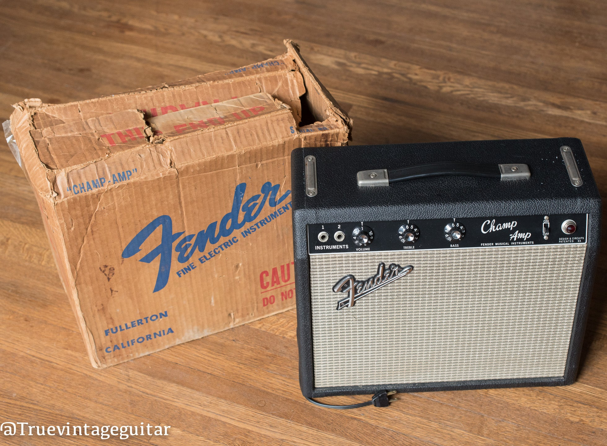 Vintage 1966 Fender Champ amp with shipping container