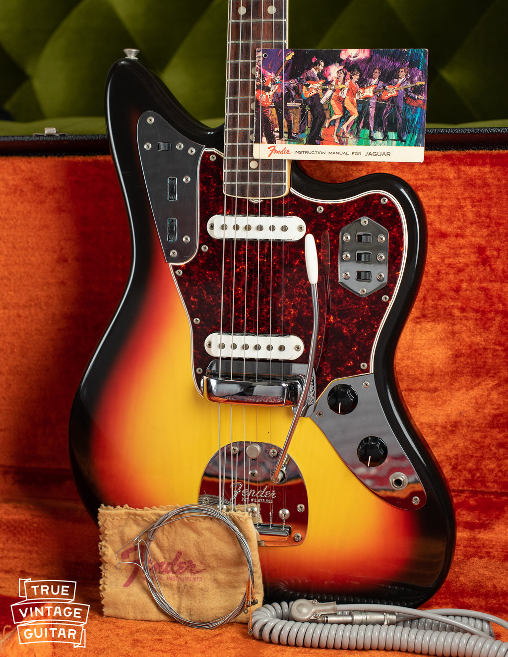 Vintage 1966 Fender Jaguar electric guitar, Sunburst finish, with hang tag and polish cloth