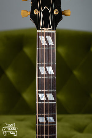 Split parallelogram fretboard inlays