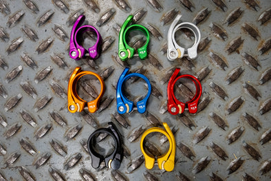 Blue, Black, Gold, Silver, Green, and Red Wolf Tooth QR Seatpost Clamps