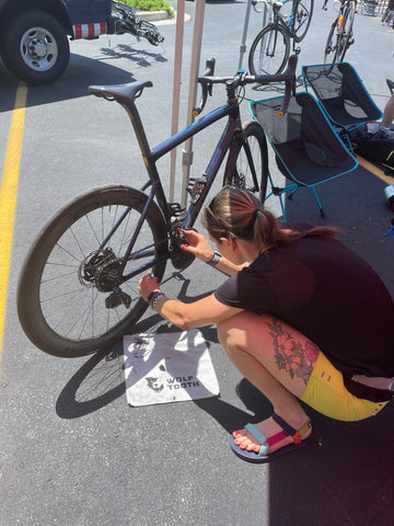 Erin using WT-1 to lube her chain on her bike