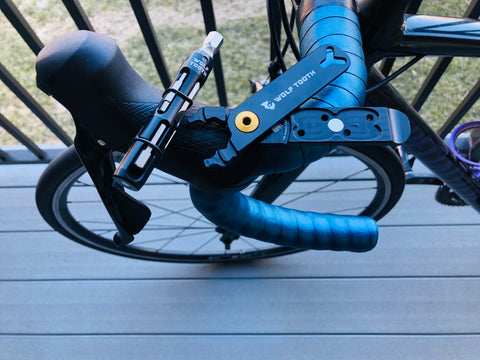 Wolf Tooth tools laying on bicycle handlebars