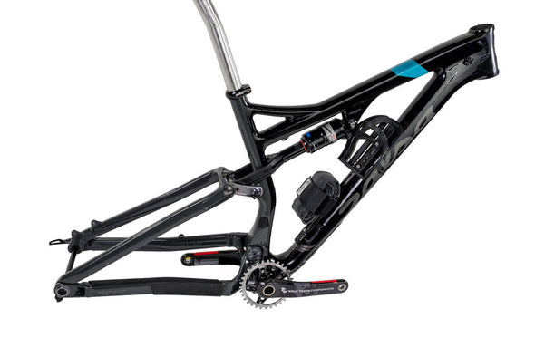 Side view of dual suspension mountain bike frame with 2 water bottle cages mounted as well as a spare tube using the Wolf Tooth B-RAD system