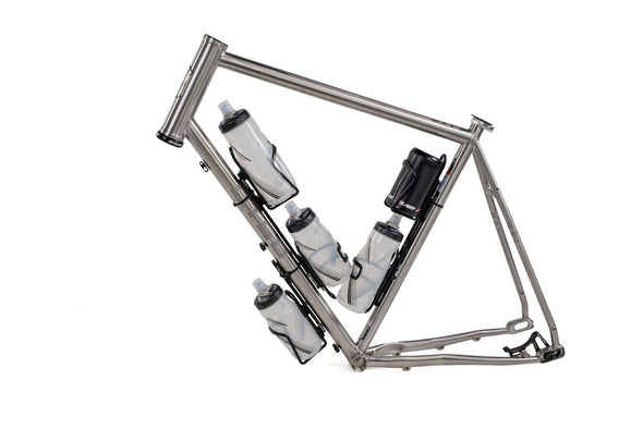 Side view of bike frame with 5 water bottle cages mounted using various Wolf Tooth B-RAD mounting systems