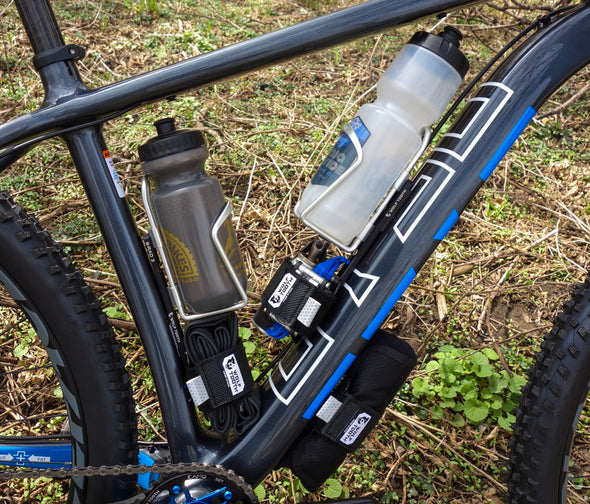 Otso Voytek bike with 2 water bottle cages, 2 tool rolls, and a spare tube mounted with the Wolf Tooth B-RAD mounting system