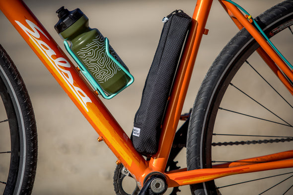 Wolf Tooth B-RAD pump bag on orange road bike close up