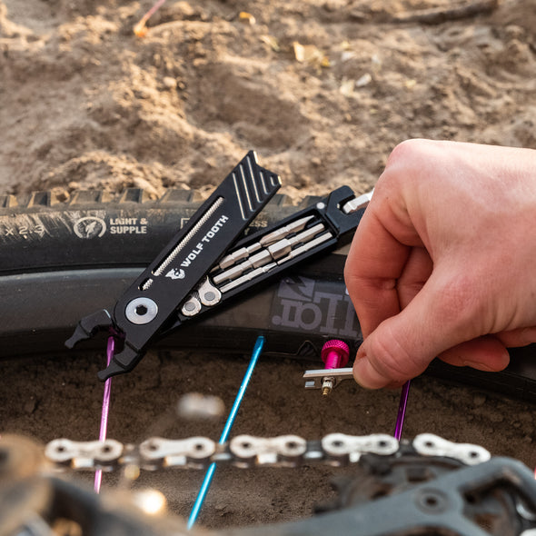 Wolf Tooth 8-Bit Pack Pliers used to loosen valve core
