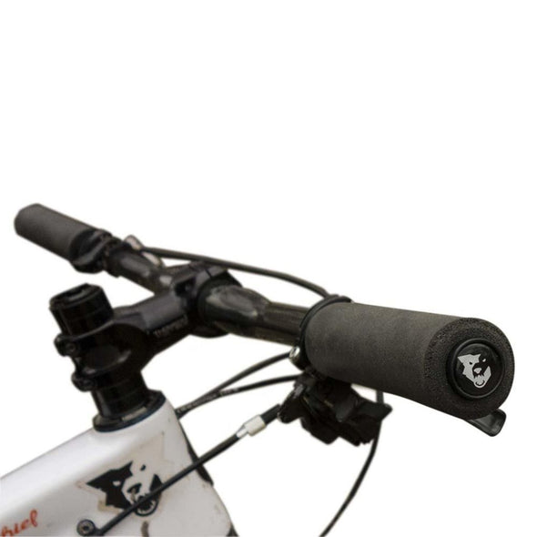 Black Wolf Tooth Fat Paw grips installed on handlebars