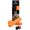 Wolf Tooth Fat Paw handlebar grips in orange both in packaging and sitting in front of packaging with bar end plugs