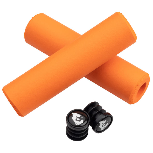Wolf Tooth Fat Paw handlebar grips in orange with bar end plugs