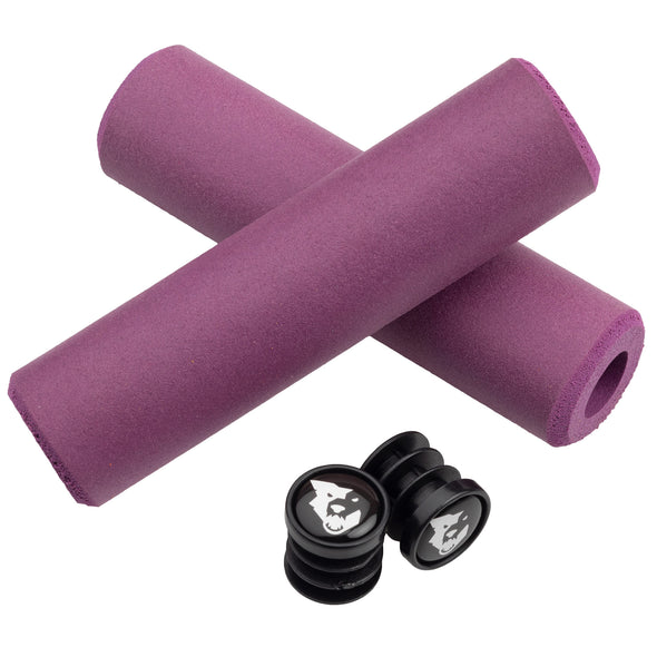 Wolf Tooth Fat Paw handlebar grips in purple with bar end plugs