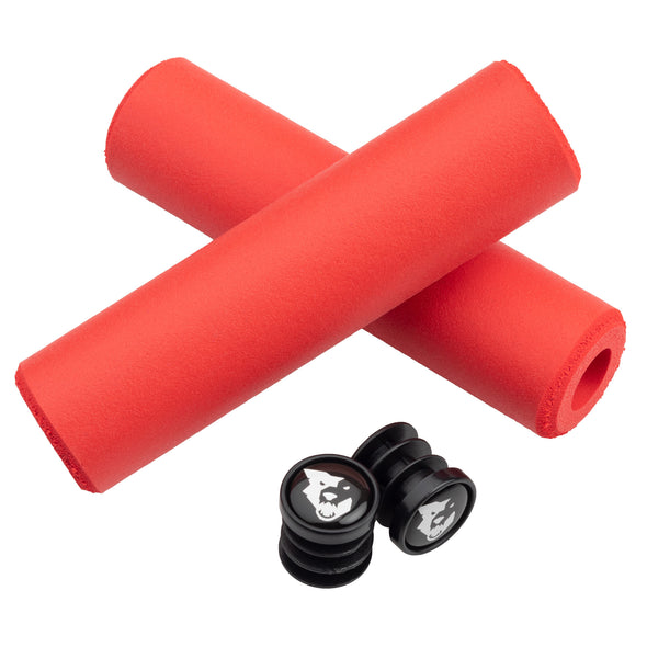 Wolf Tooth Fat Paw handlebar grips in red with bar end plugs