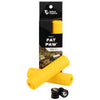 Wolf Tooth Fat Paw handlebar grips in yellow both in packaging and sitting in front of packaging with bar end plugs