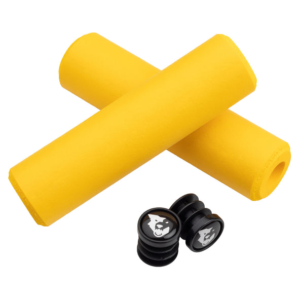 Wolf Tooth Fat Paw handlebar grips in yellow with bar end plugs