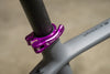 Wolf Tooth QR Seatpost Clamp in Purple installed on bike