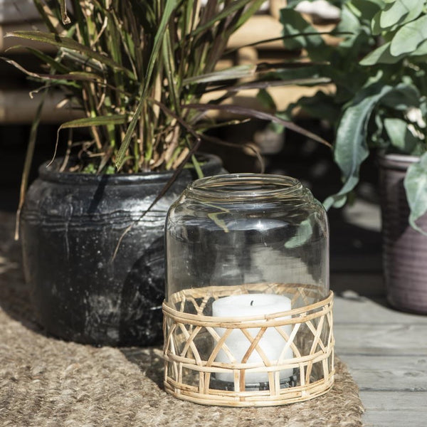 glass bell jar lantern or vase with woven straw cover