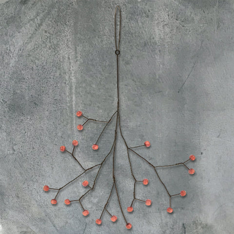 hanging metal decoration with wooden red berries