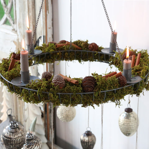 hanging zinc wreath with four candle-holders