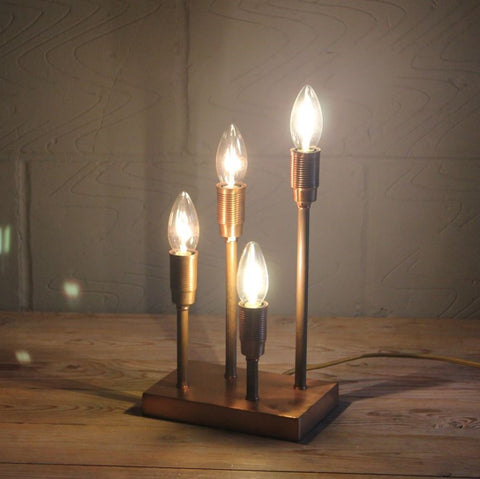 copper table lamp with four bulbs
