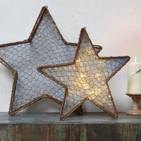 rustic chicken wire and zinc star wall art