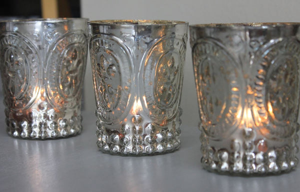 four mercury glass tealight holders