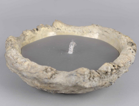 grey outdoor garden candle in stone bowl