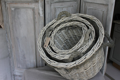 Set of three grey willow baskets