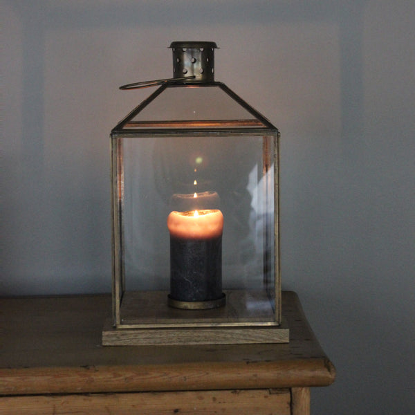 antique brass and glass lantern with rustic wood base