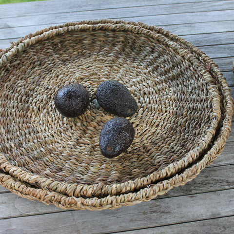 large round seagrass platters