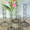 Set of three wire and glass stem vases