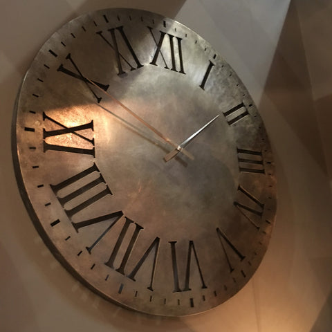 very large metal clock with roman numerals