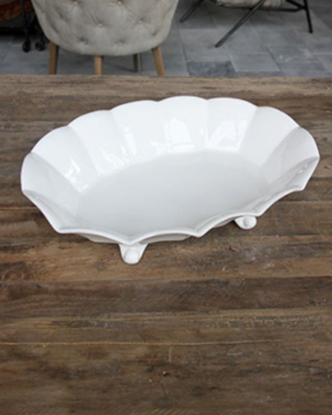 large white scalloped edge ceramic serving dish on feet
